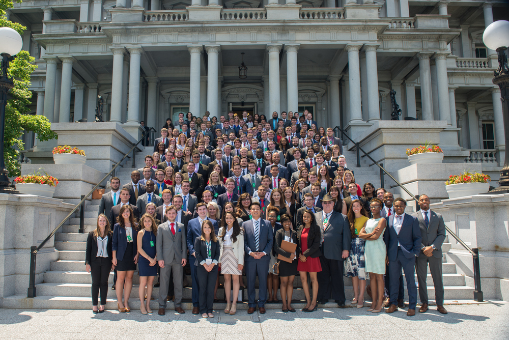 The whole group outside the White House Eisenhower Executive Office Building.