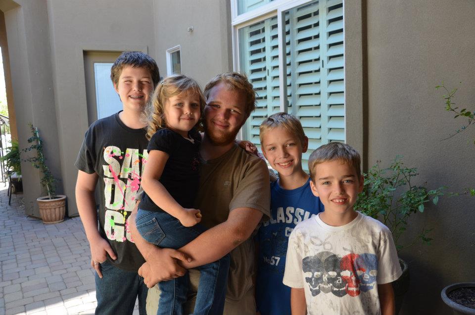 spencer back home with siblings.jpg