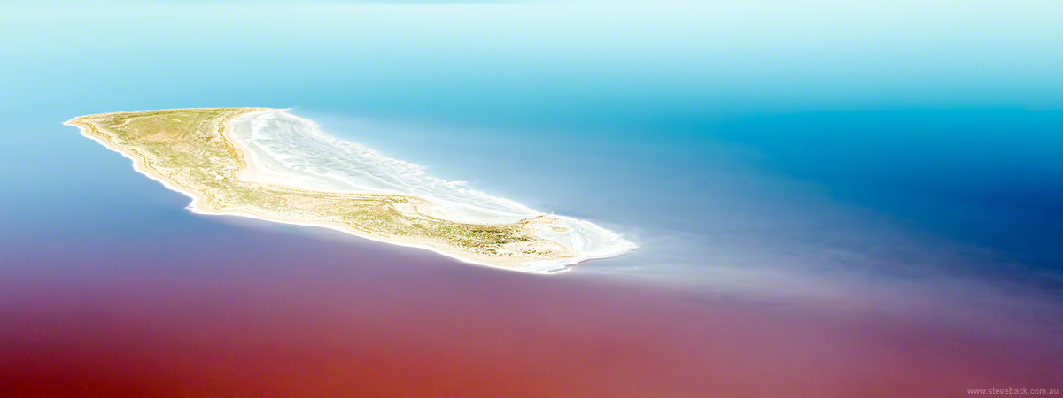 Aerial shot of island in Lake Ayre, which is now largely full of water.  The reddish hue is due to algae in the water.