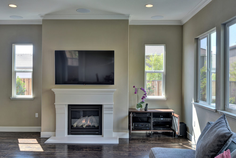 Family room LG 65-inch 4K UHD TV with Paradigm 5.1 in-ceiling speakers and Salamander Designs AV cabinet