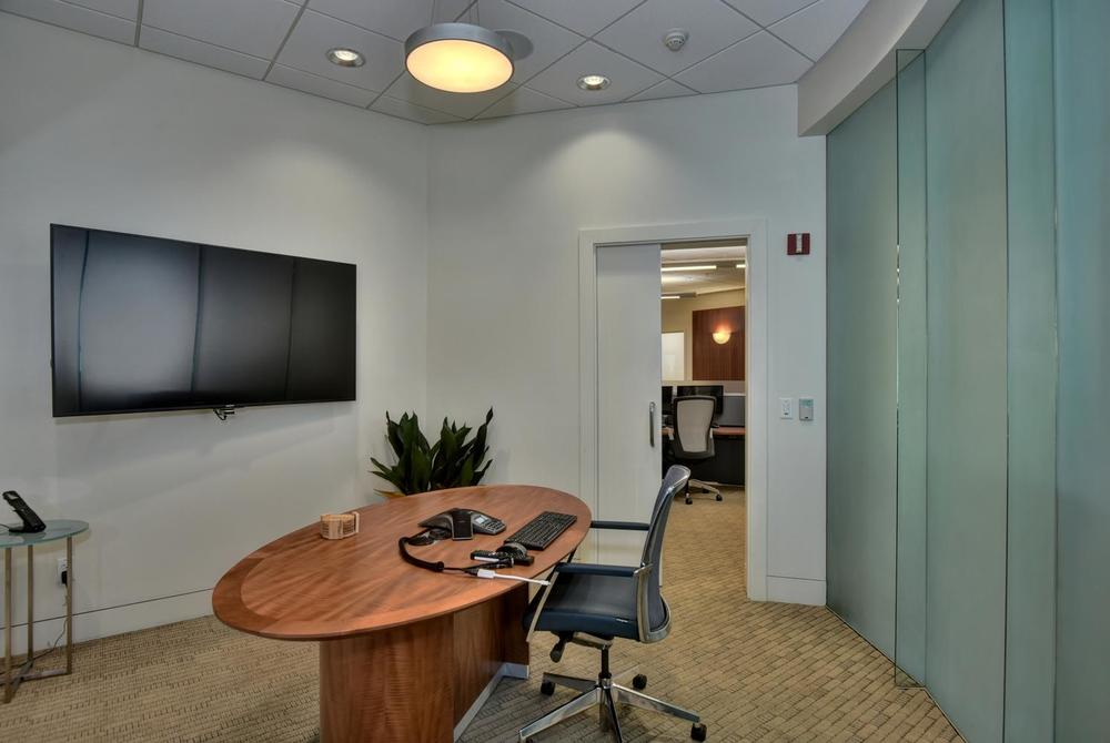 Meeting room with Sony 4K UHD TV and Definitive Technology in-ceiling speakers
