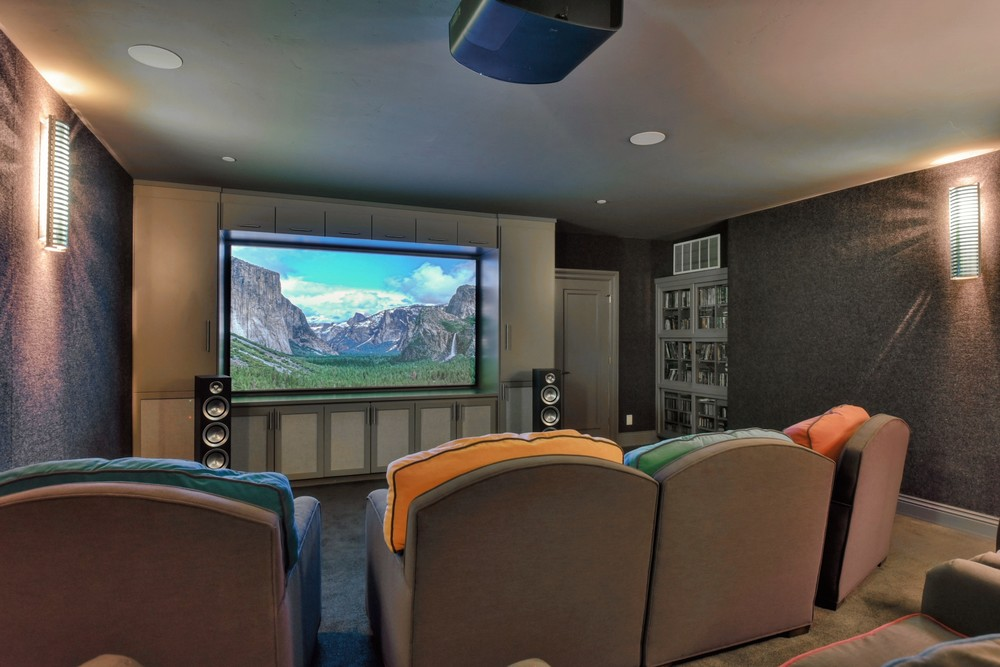 Dedicated home theater with Sony 4K projector and Dolby Atmos 7.1.4 Paradigm Prestige Series speakers