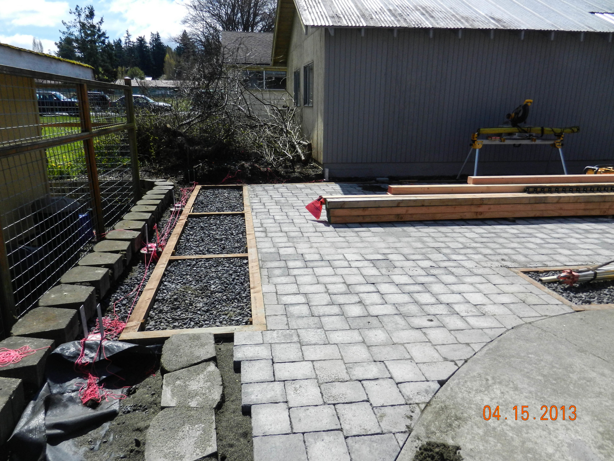 Garden beds being built and pavers in place