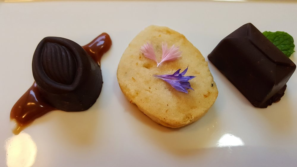 Housemade Petit Fours Dark Chocolate Mousse, Orange & Thyme Shortbread, Peanut Butter Mousse