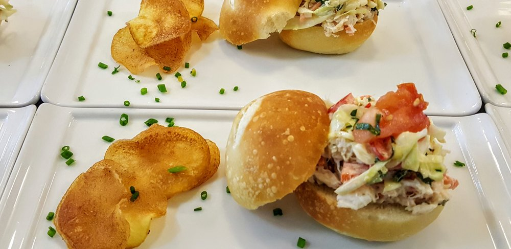 Dungeness Crab Slider  House-made french roll, cabbage & basil slaw, tomato confit & house-made potato chips