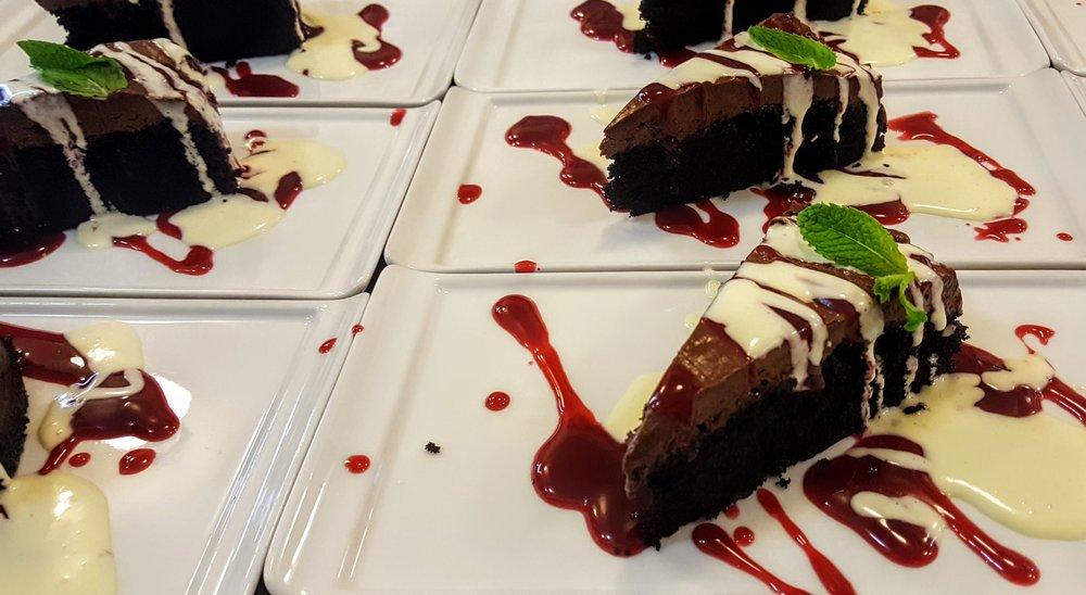 Chocolate Trio Cake  Chocolate cake, dark chocolate mousse, white chocolate sabayon, raspberry coulis