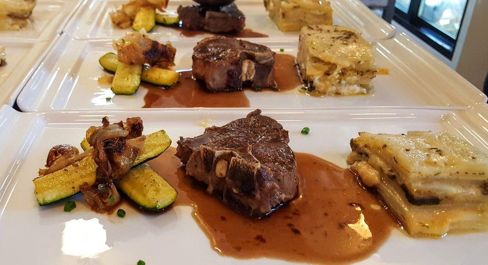 Pan-roasted Lamb Chop  Potato, rapini, crimini mushrooms & gruyere cheese gratin, caramelized zucchini & cipollini onions, red wine demi