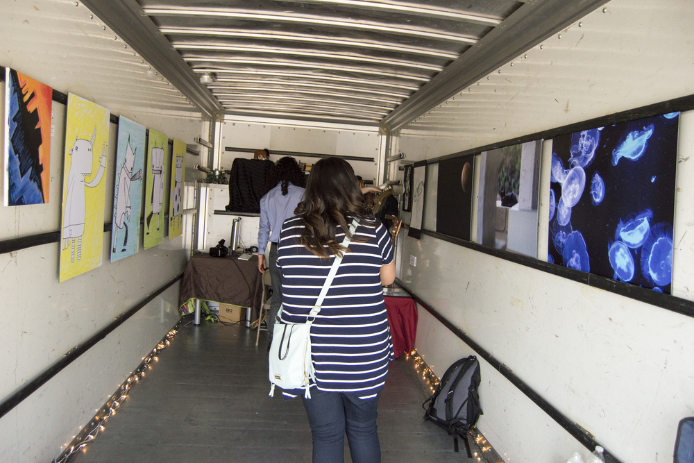Rosy Razo viewing the art and pondering how the artists made it.
