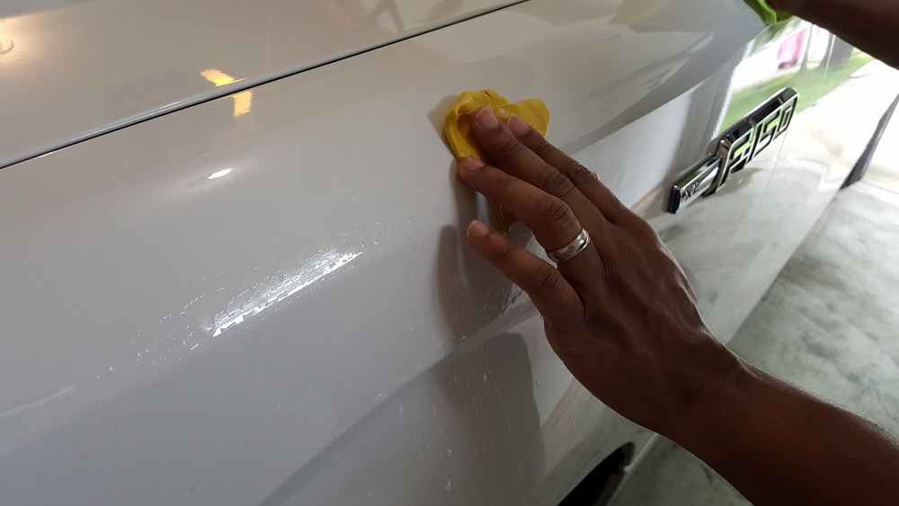 Clay bar removing paint contaminants before wax