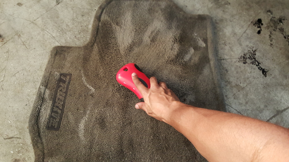 The carpet brush helps lift the stains out of the carpet and into the APC foam.