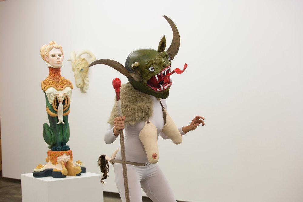She Devil performed by Legs 11 11, hand built ceramic ,remodelled bike helmet, bull horns, polymer clay, oil paint, fake fur, remodelled stilettos, 2017
