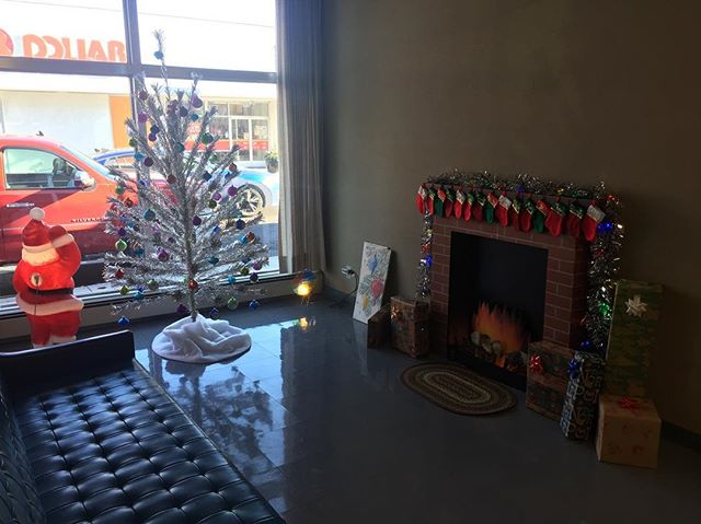 "Cozy up by Fairmount State Bank's faux fireplace and Christmas tree with Santa in their window for this year's Main Street Fairmount Holiday Window Decorating Contest! If you'd like to see  them win, stop in their bank and vote with your $$! The business who raises the most money wins! All proceeds go to Main Street Fairmount to continue to help Fairmount thrive! You also may pay using PayPal.me/mainstreetfairmount  and write their name in the ""note."" #mainstreetfairmount #fairmountindiana"