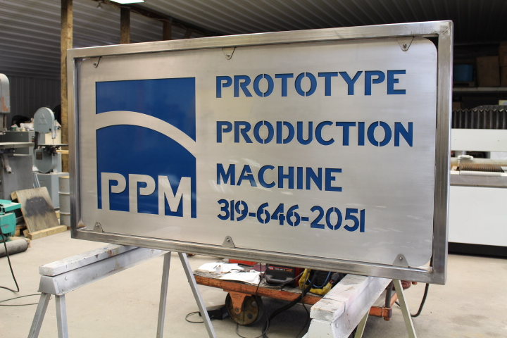 Local machine shop's custom double sided sign, made with 3x2 stainless frame. This has brushed aluminum panels with PPG clear coat. Customer picked out the Ford Lapis blue for a color contrast.