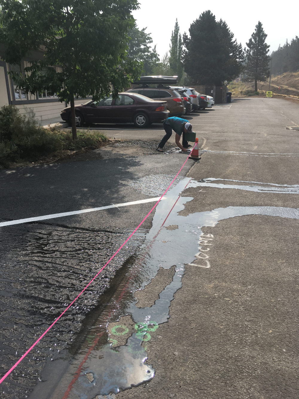 There was more than just one sprinkler head that was affected by the new asphalt paving.  an irrigation consultation to locate sprinklers and advise on how to cap them would have been a fraction of the time and money it took to locate the paved-over sprinklers and to make the necessary repairs.