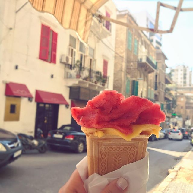 """Touristy tidbit: Lebanon's """"best unkept secret"""" is a tiny, white-painted shop in an unsuspecting bullet-marked Achrafieh building...a family-owned ice cream parlor unchanged since 1949, persisting through the 15-year civil war. Thank you to our favorite Beirut tour guide @mariamynabbout for taking us💛🍦 Flavors pictured here: amareddine (apricots & pine seeds) and my classic strawberry sorbet🍓🏡 (swipe for the aftermath) #hannamitri #bouza #achrafieh #beirut"""