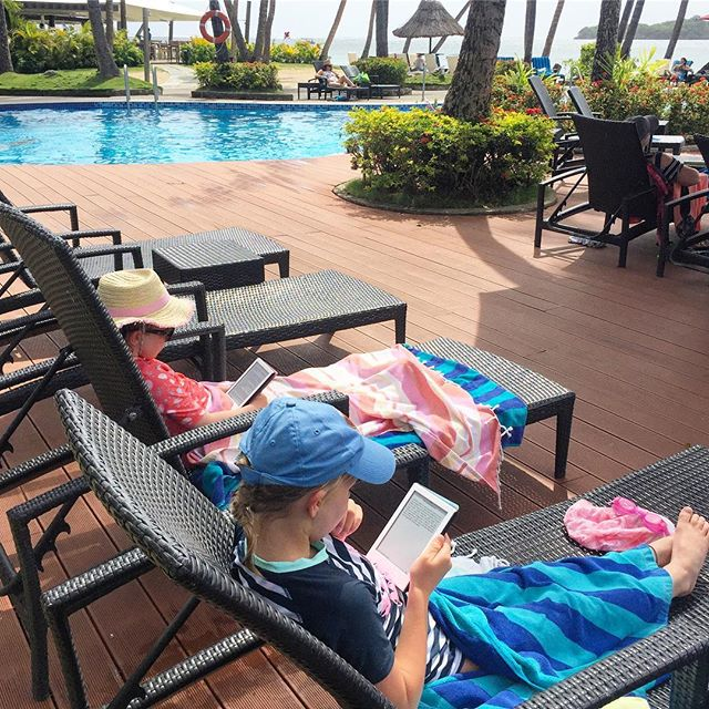 Oh how I love these little geeks 🤓 Taking a break from the pool and sitting quietly with their kindles - Harry Potter and Aesop's Fables are what they're currently reading 📖 ... Hands down the best Christmas present we've ever bought them and such a great travel accessory(Although I'm now the only one without, d'oh!) #kindlekids #kidsreading #kidsthatlovetoread #booksonthebeach #homeschooling #worldschool #travellingwithkids #familytraveltips #travellingpotterfamily #amazonkindle #simplelife #happyholidays2018 @fijiforfamilies @shangrila.fiji #shangrilafiji #harrypotterfans