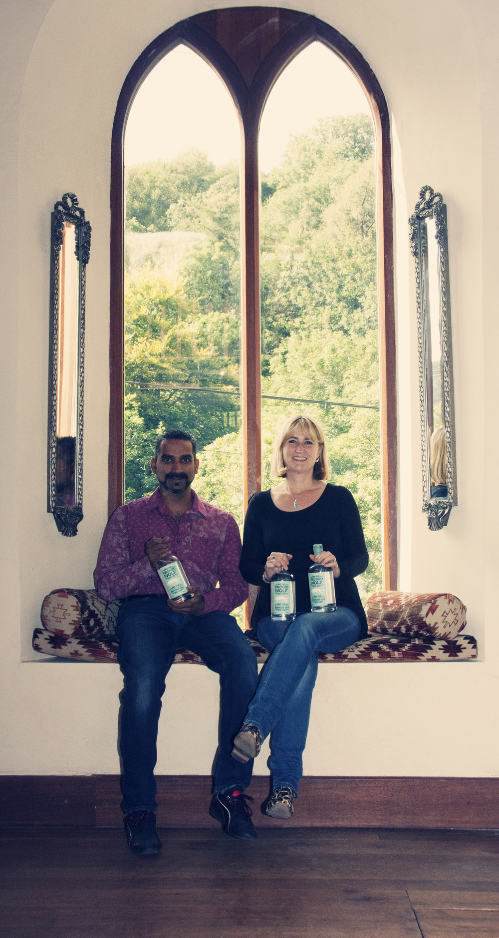 Pat and Julie with their gin, in their now restored Methodist Chapel, built around 1837