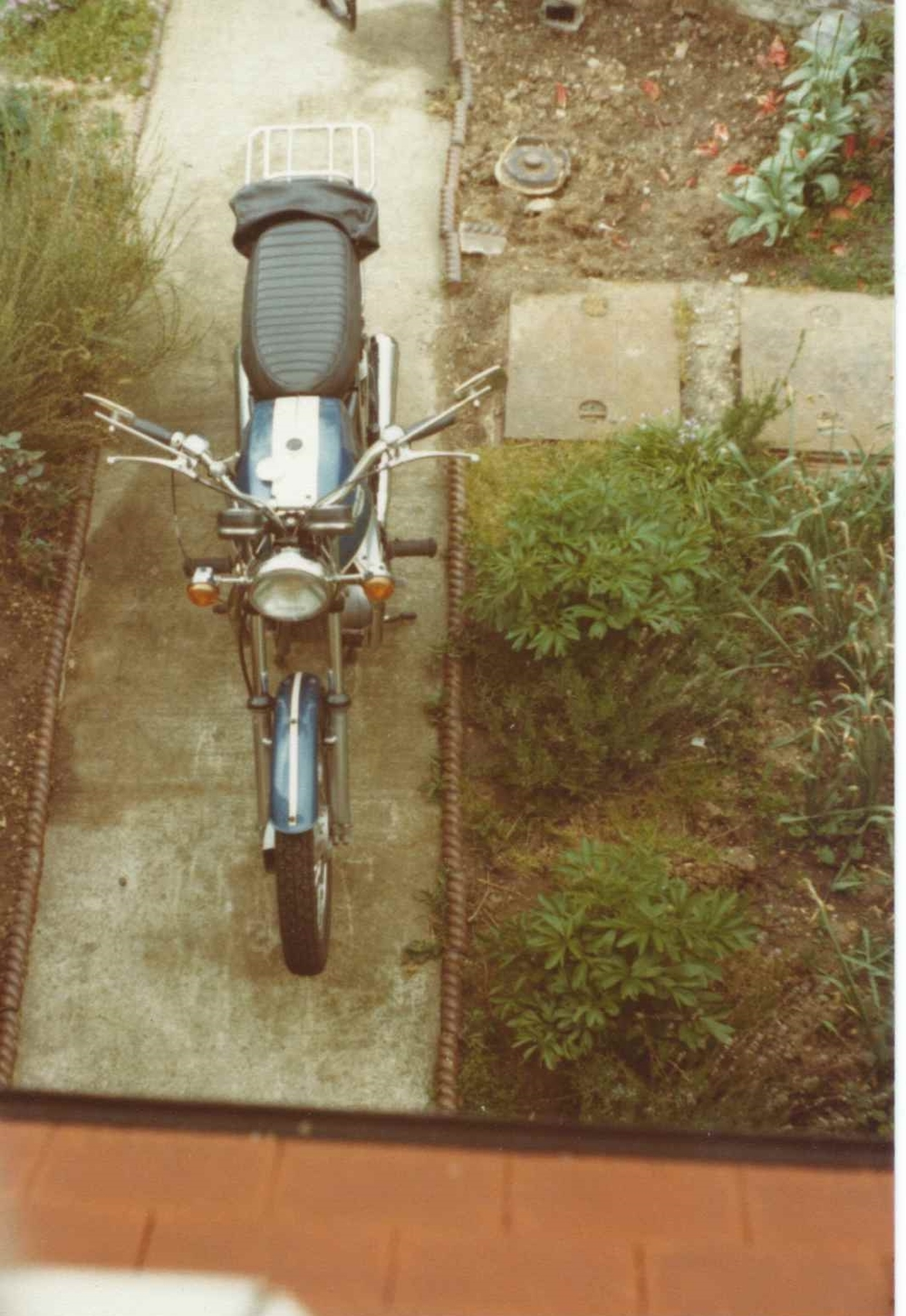 "Dad's Triumph Tiger 650, with aftermarket ""cow horn"" handle bars."