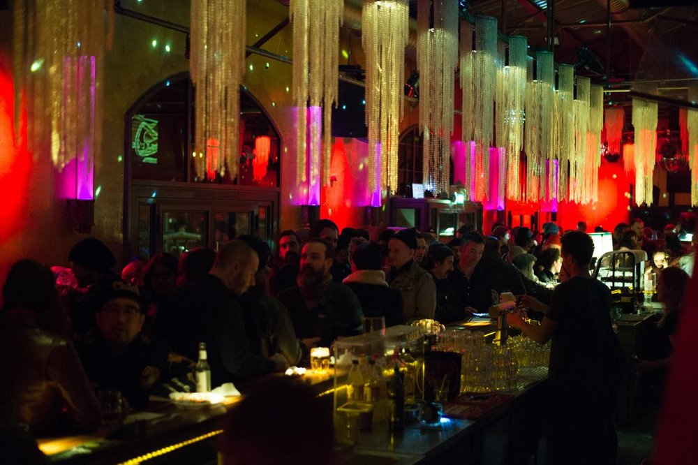The packed bar at the opening night party