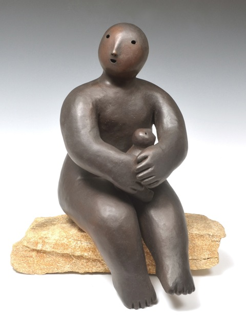 sitter holding animal  bronze 42 x 27 x 27 inches