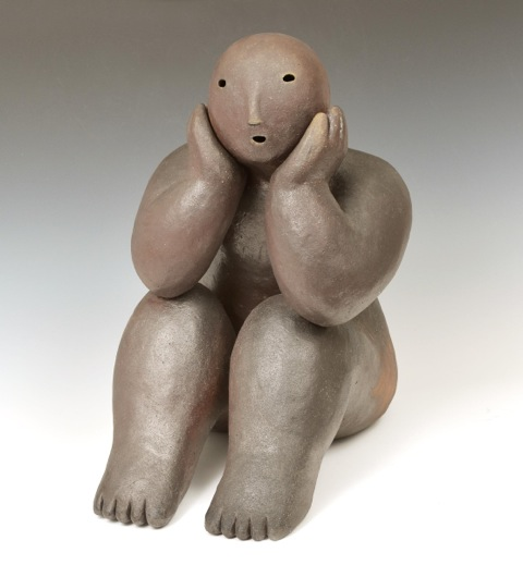 sitter with head in hands  wood fired stoneware 16 x 10.5 x 15 inches