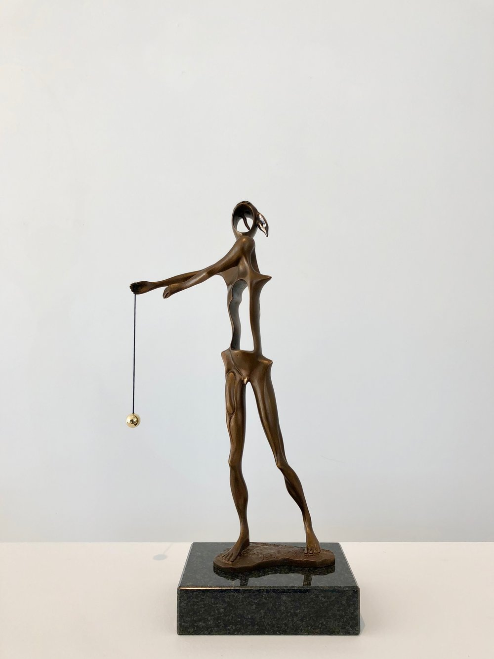 Homage to Newton , 1980 Bronze 13 99/127h x 4 42/127w x 6 13/127d in