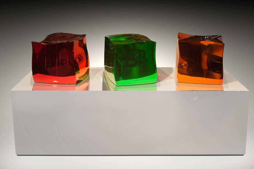 Jello Cube Trio , 2016 Mirror polished stainless steel and transparent color 38h x 74w x 30d inches
