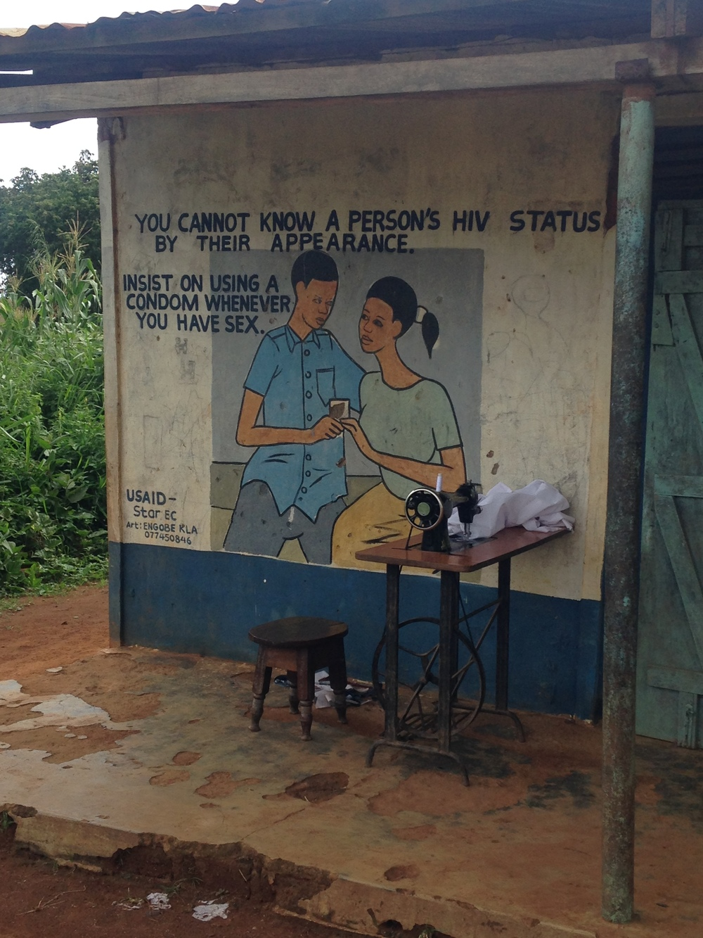 HIV/AIDS testing awareness advertisement seen on the side of a local shop on Sigulu Island.
