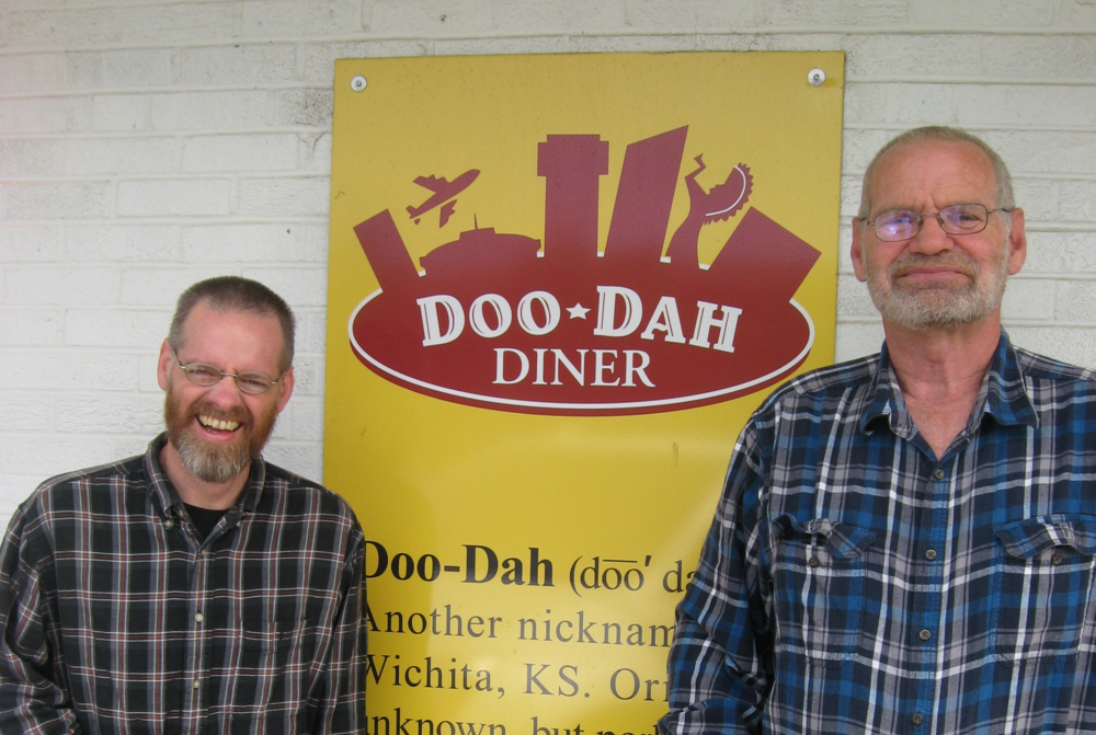 Matt (left) and Mark (right) in front of the Doo-Dah Diner. Mark apparently cracked a joke right before the picture, so Matt got caught laughing.