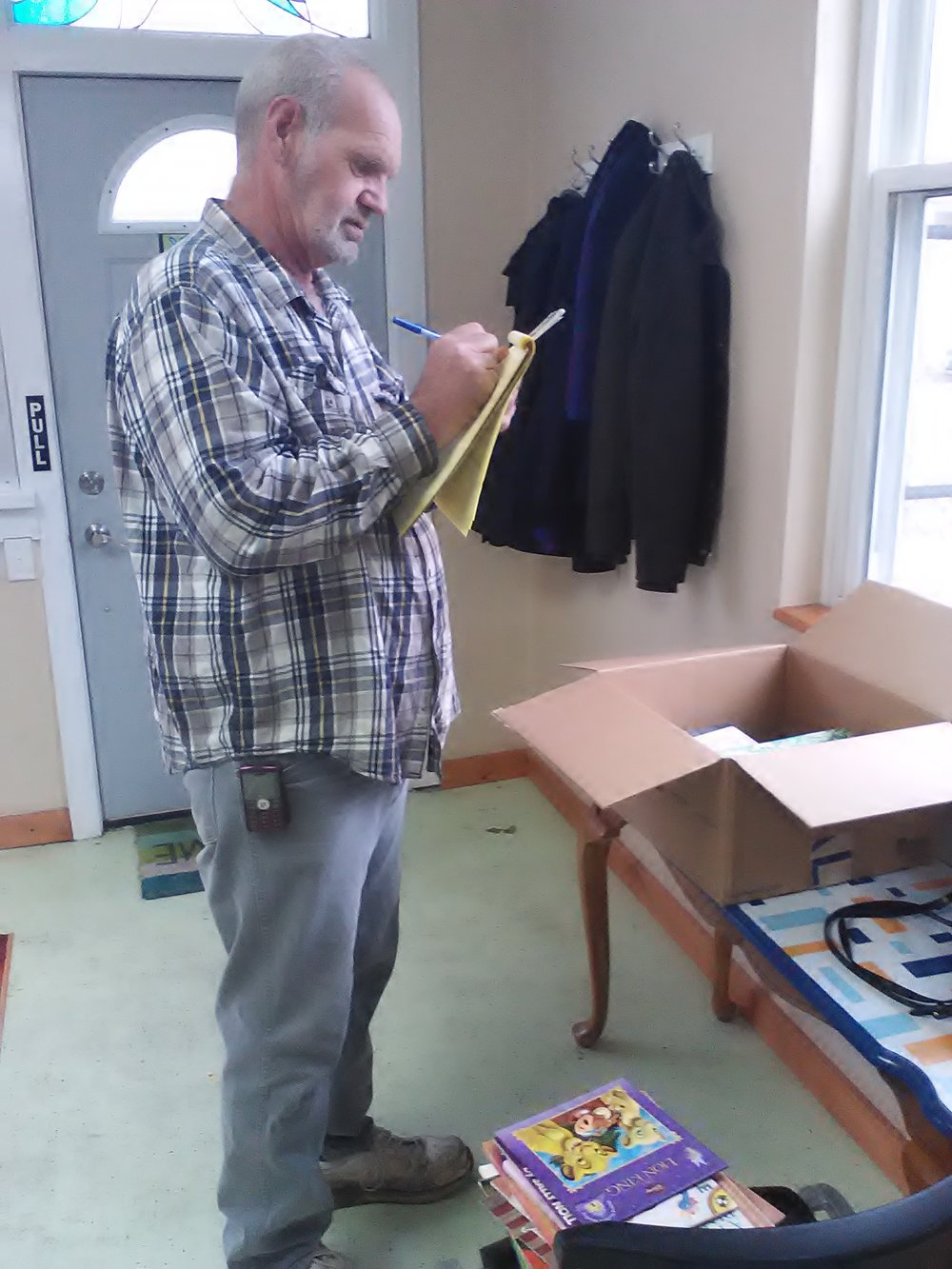 Mark prepares the Little Free Library books.