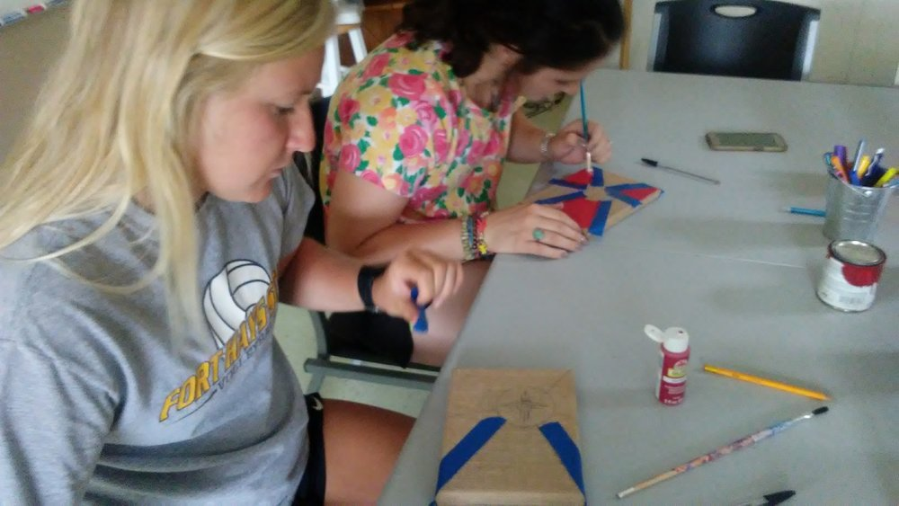 AJ (on the left) making a Wichita flag painting.
