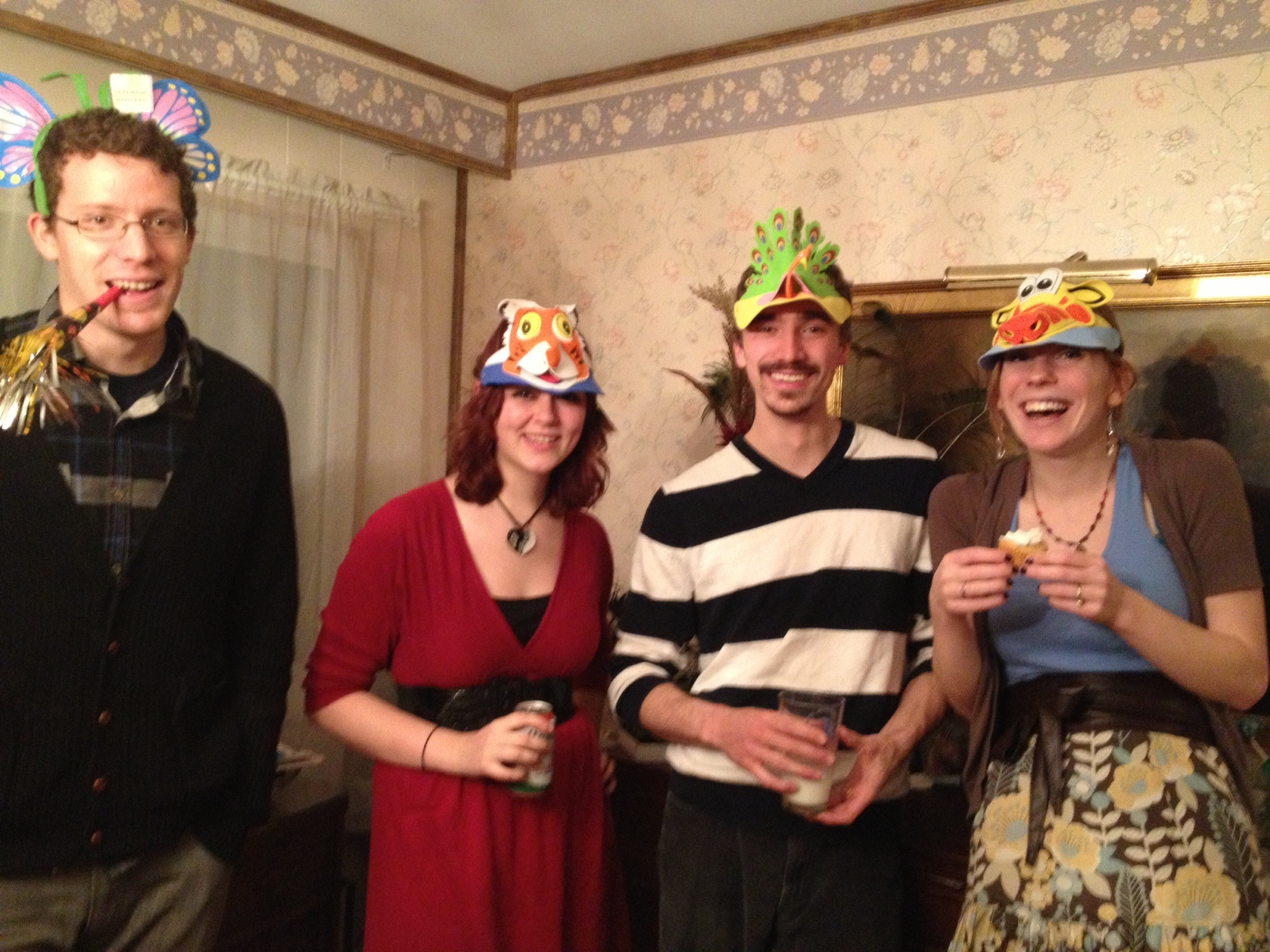 Yup. Those are animal hats. Because we party like adults.From the left: Dragon, John Hamm, Gumby, Me!