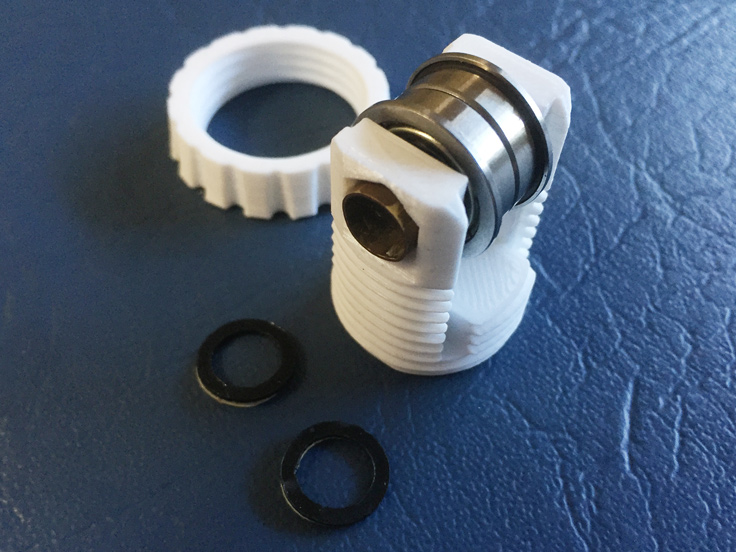 A 8mm diameter brass tube was cut to length and used to hold the bearings in place.  The small washes where used on the X-axis belt tensioner to keep the bearing centre.