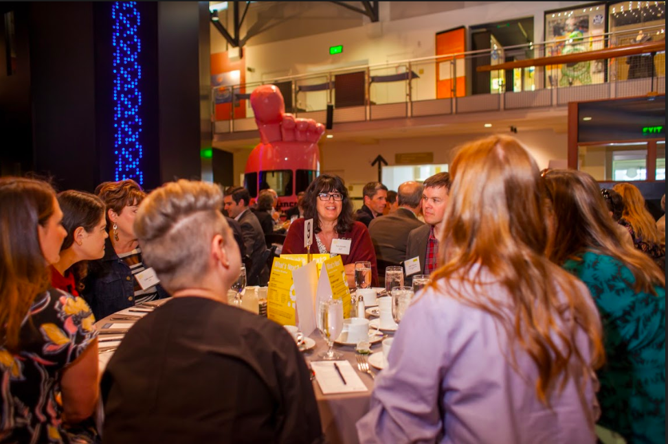 CTO and Co-founder, Scott Thielman, serves as the Featured Innovator at a table of guests for the 2018 MOHAI Innovation Breakfast.