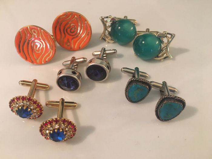 Cuff links made from old clip on earrings.