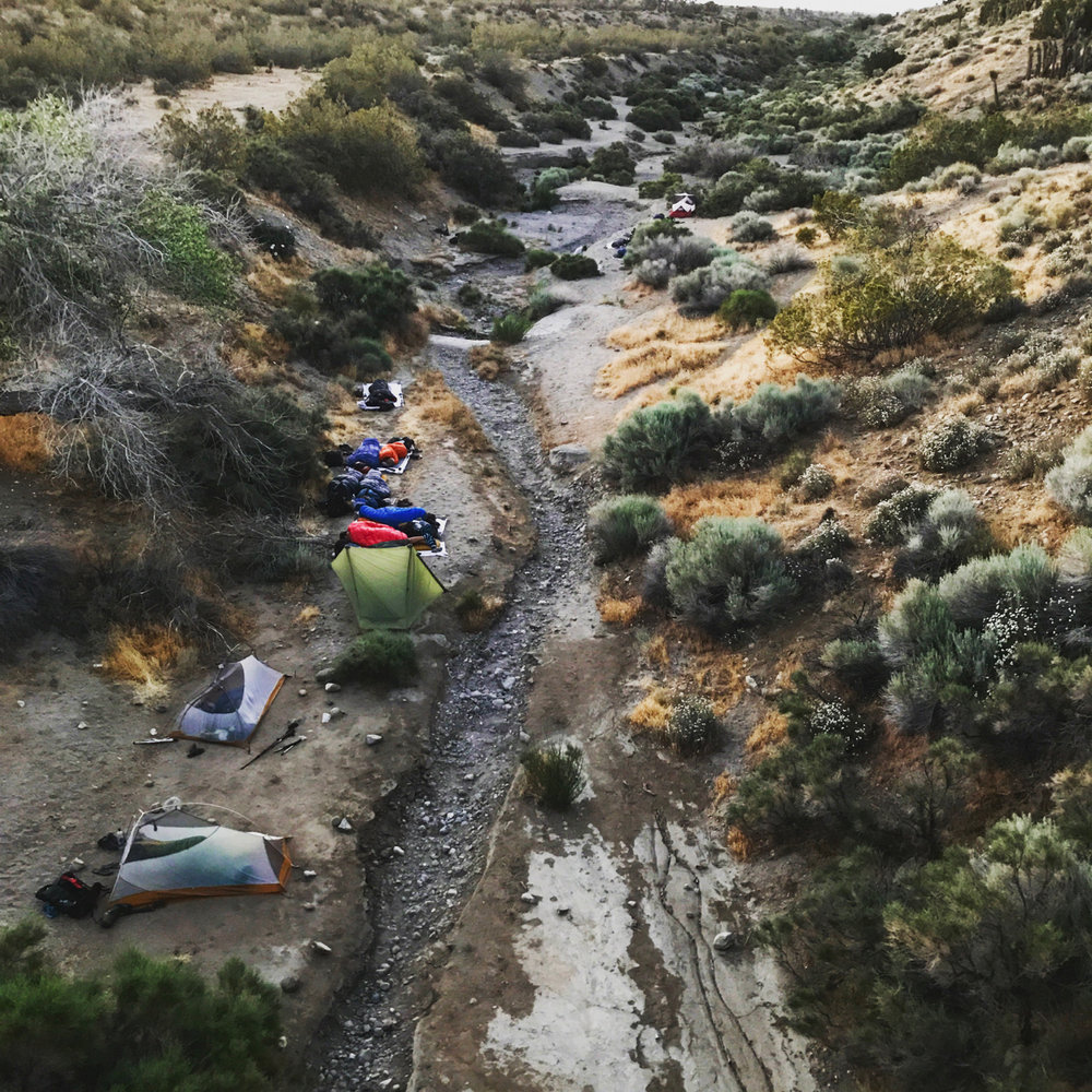 Throngs of tents littering the creek bed at the end of the 17-mile aqueduct hike