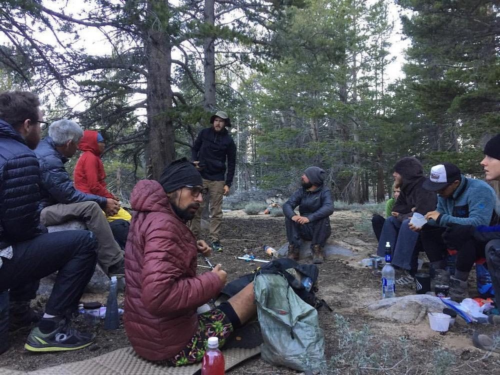 Morning huddle and ice ax instruction. Photo Credit: Sara Read