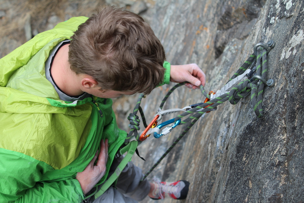 In this moment, the climber is connected to the original tie-in, the bight-knot and locking carabiner, and the fifi.  It's a good time to double check the system.