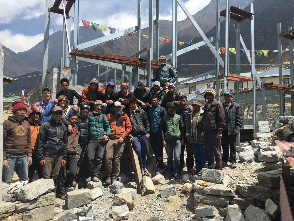The building crew at the Khumbu Climbing Center, along with Conrad Anker, Jenni Lowe-Anker, and Brandon Lamply, the head contractor on the project.