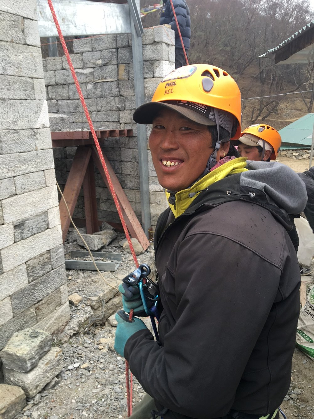 Donuru Sherpa, a 17-time Everest summiter, helps to belay a steel joist into position on the Khumbu Climbing Center.
