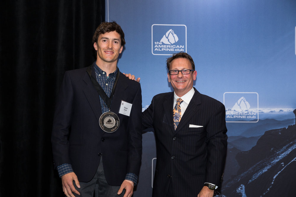 Phil Powers presenting the Bates Award to Mason Earle. Photo: Tegra Nuess