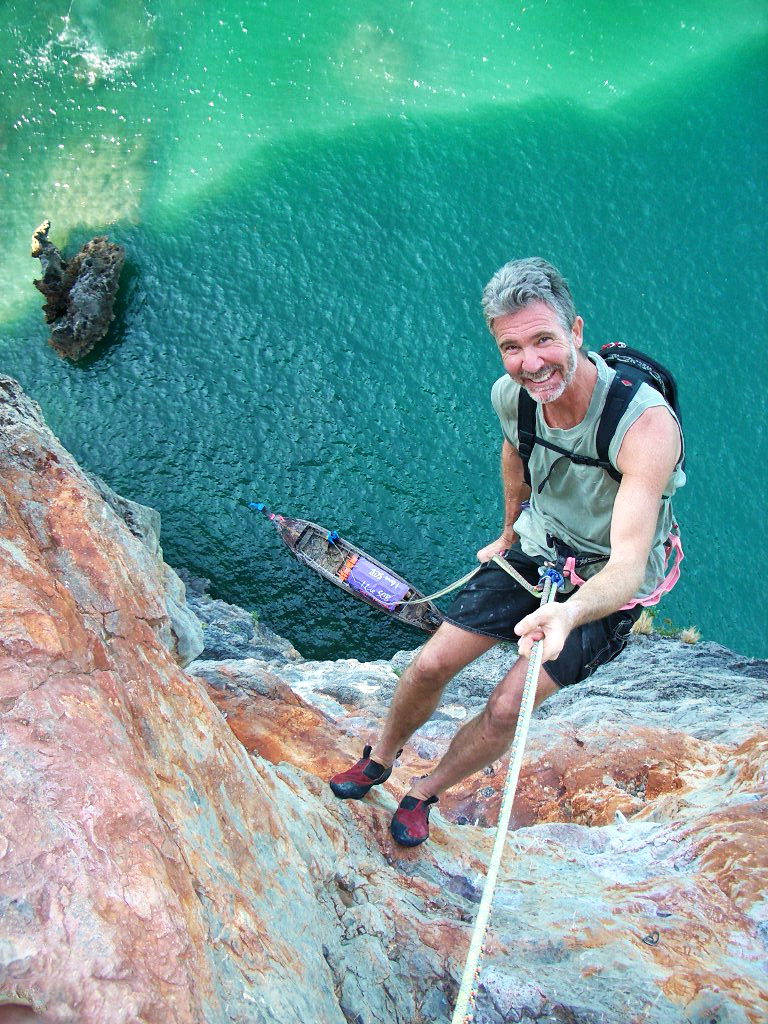 Chris Noble rappels off a climb in Thailand.