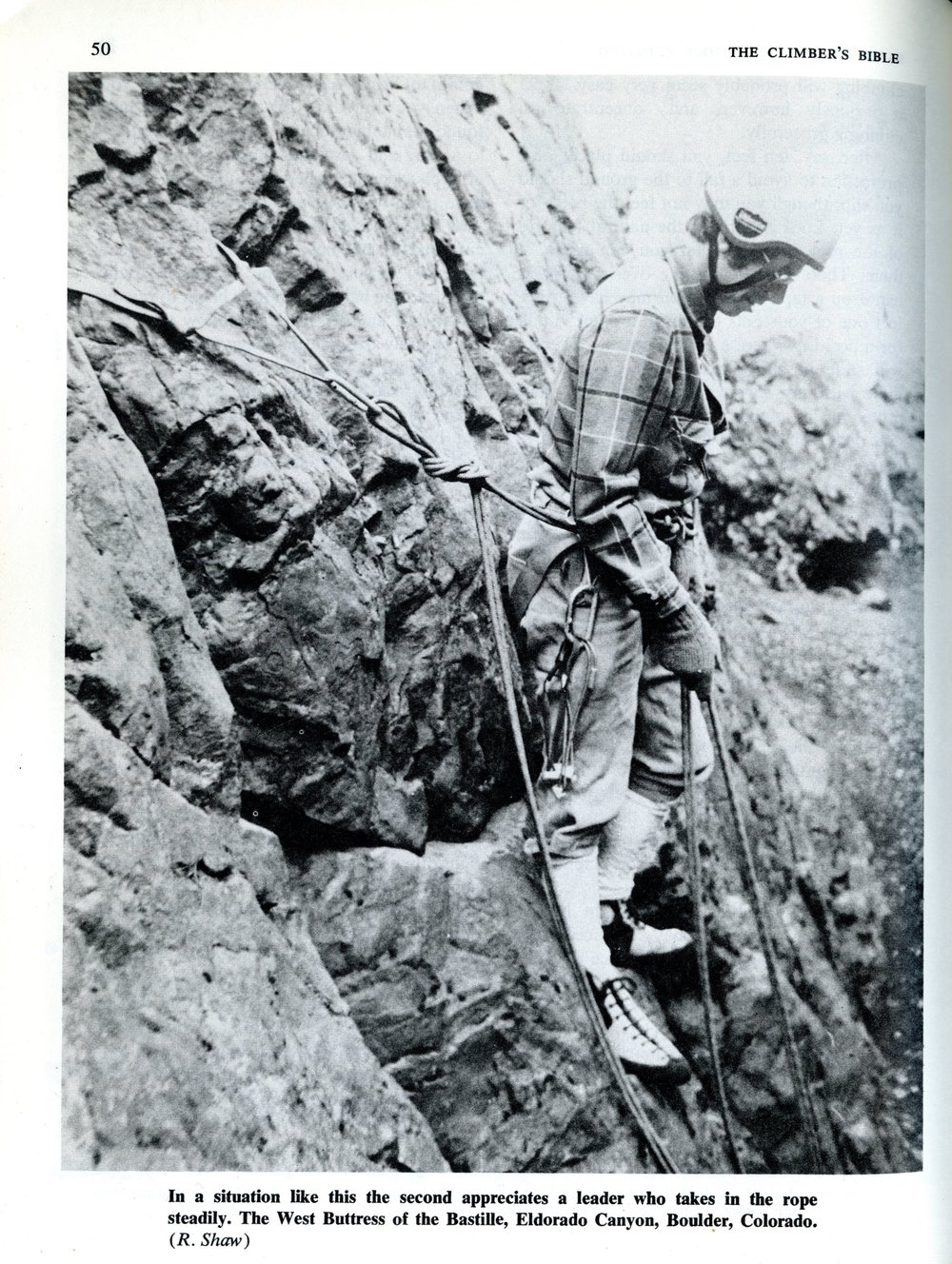 This image, taken from  The Climber's Bible  by Robin Shaw circa 1983, typifies the instruction of anchoring in a previous era.  The belayer uses his stance to guard the anchor.