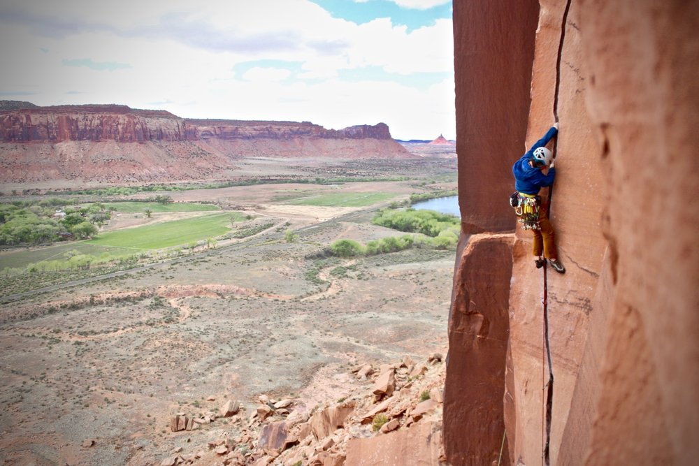 Betsy Manero climbs an Indian Creek classic. The Creek, a part of Bear's Ears National Monument, is now under threat.  Emma Longcope photo.