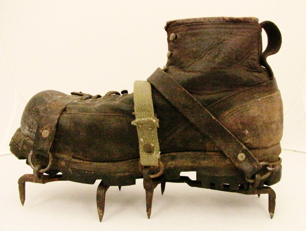 A steel crampon with eight spikes and hemp and leather straps - ideal!    From the American Alpine Club Library archives