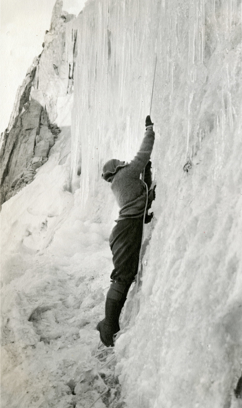 Elmina Buhl dropping into a bergschrund on Fremont Glacier in 1924