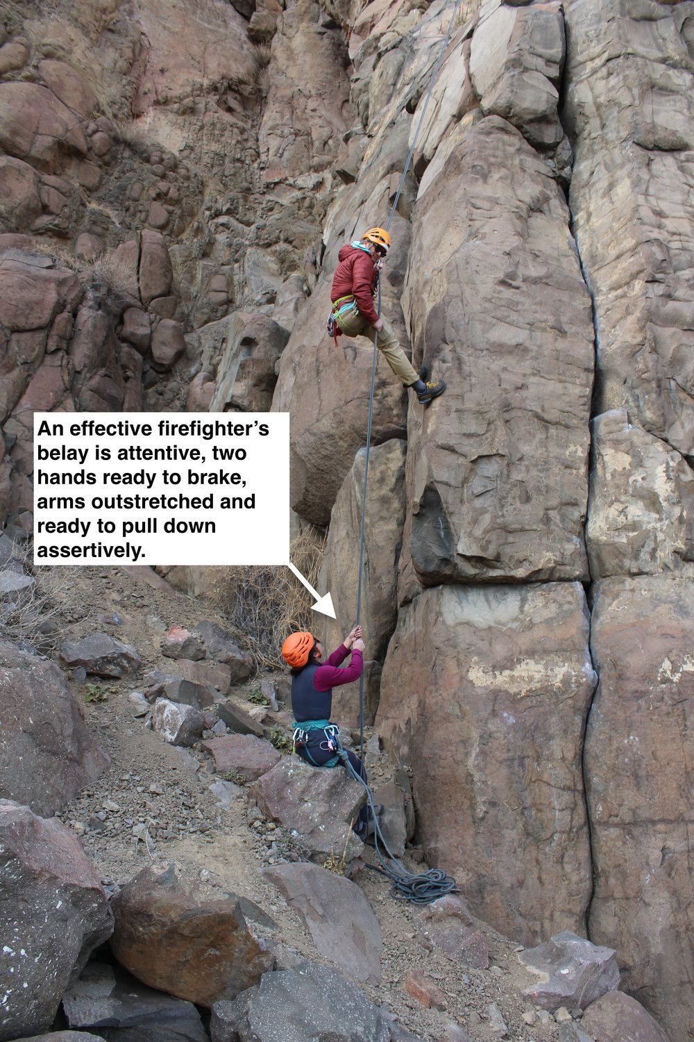 When this climber offers a firefighter's belay, she means it.  She's attentive and ready to halt the rappeller at any moment.