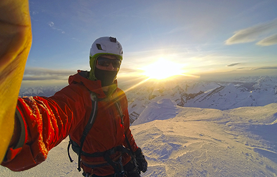 Sunset selfie on the summit of Mt. Robson after soloing the Emperor Face.