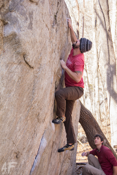 AAC member Justin Fricke climbs in Chimney Rock State Park, WV. Photo Credit-Adam Fricke