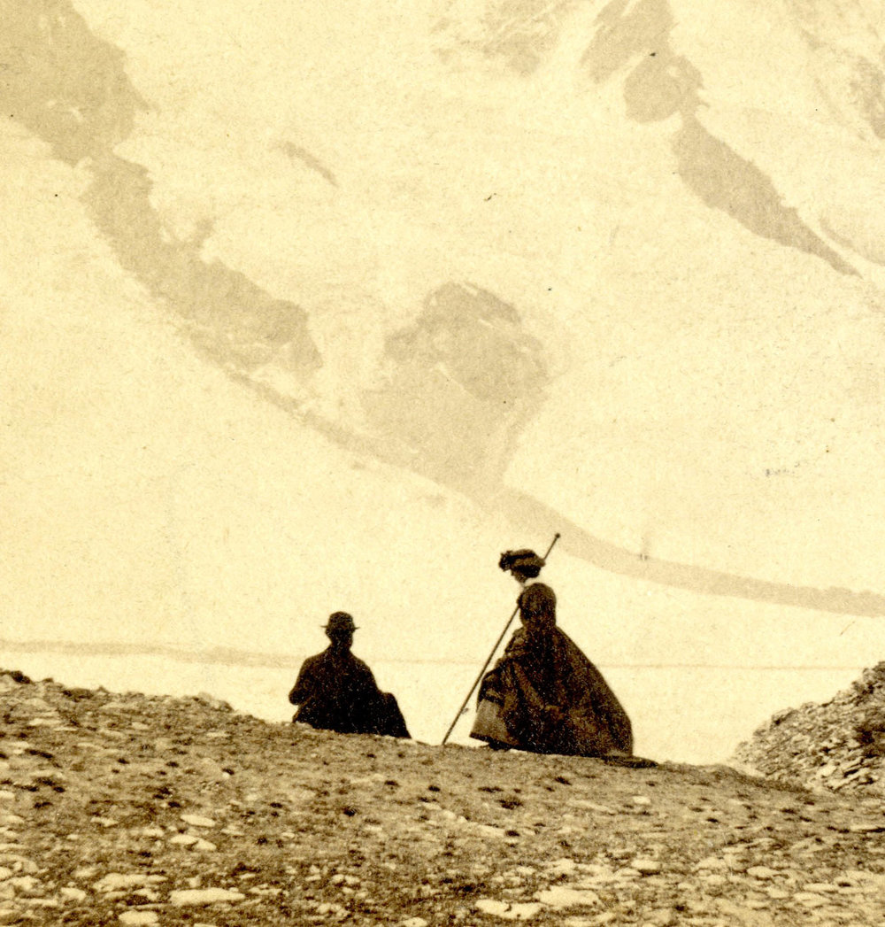 A woman of the late 1800's holding her alpenstock. This variety also has no cutting tool attached.